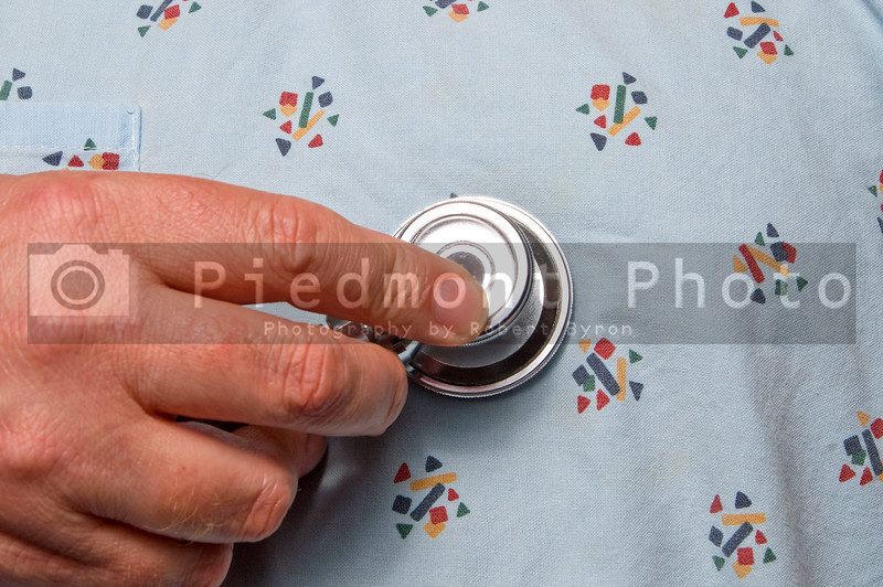 A patient being examined with a medical stethoscope..