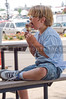 A young boy eating an ice cream cone.