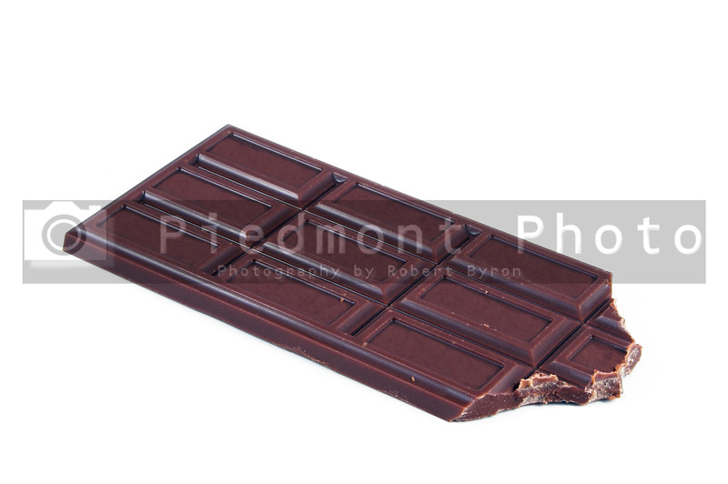 A delicious chocolate candy bar on a plate.