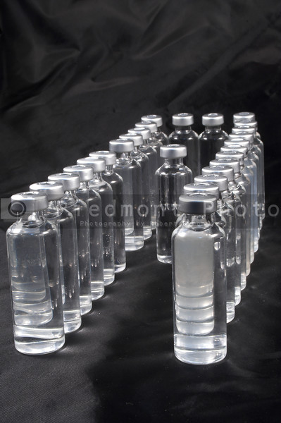 A collection of prescription medicine vials.