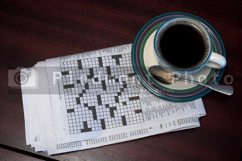 Morning coffee and the newspaper crossword puzzle.