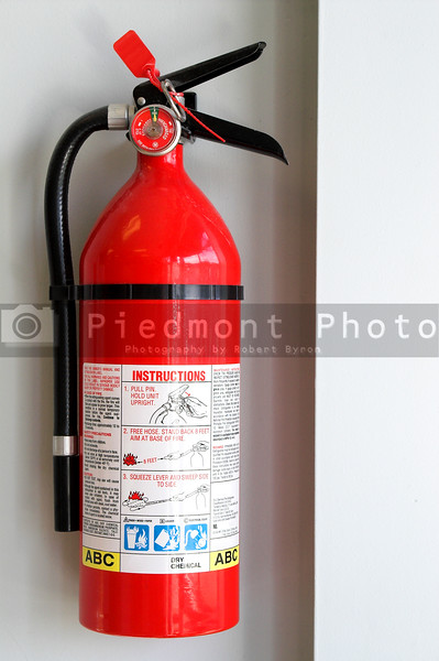 A fire extigusher mounted to the wall.