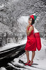 a beautiful woman elf holding a big Christmas stocking