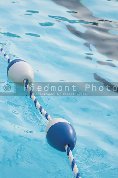 A buoy and rope swimming pool lane marker.