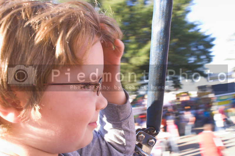 A young boy on a carnival ride.