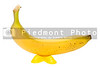 A bright yellow banana with vivid yellow feet.
