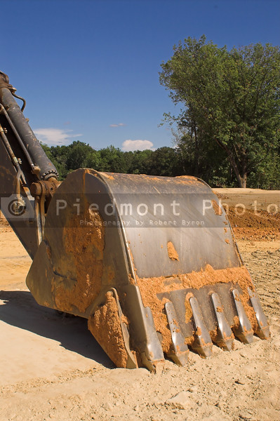 An industrial excavator at a construction site.
