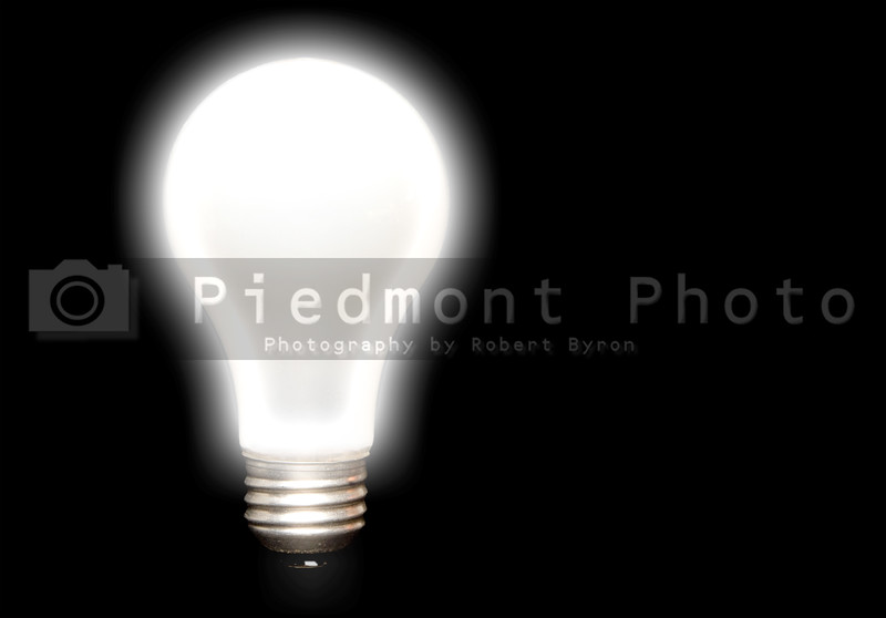 A bright turned on incandescent light bulb.