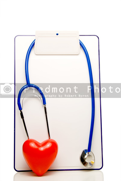 A medical chart, stethoscope and heart shape.