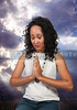 Beautiful Christian woman in deep prayer