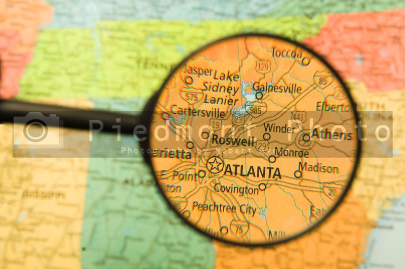A map of Atlanta, Georgia seen through a magnifying glass.