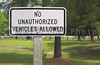 A sign stating No Unauthorized Vehicles Allowed.