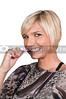 A beautiful woman practicing good oral dental care by brushing her teeth