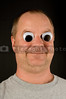 A silly man with wiggly googly eyes.
