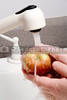 A person vigorously washing a delicious apple.