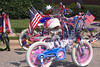 Assorted bicycles decorated for the fourth of July.