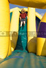 Boy on Inflatable Slide