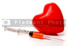 A Medical Syringe and a big red heart.