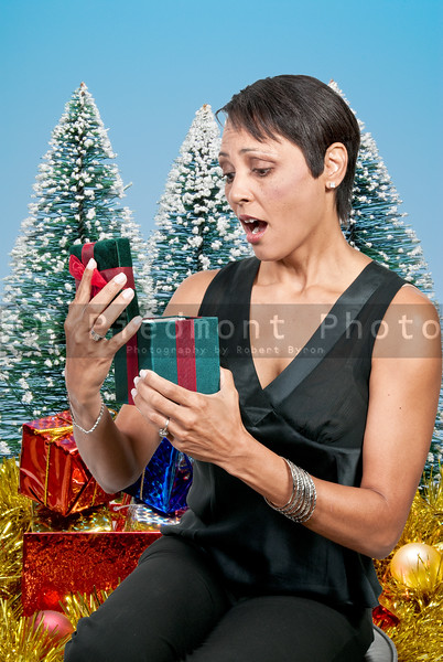 Beautiful woman opening a Christmas present