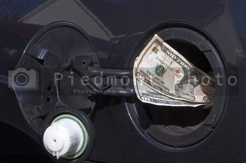 Pouring money in to the gas tank - the high cost of gasloline.