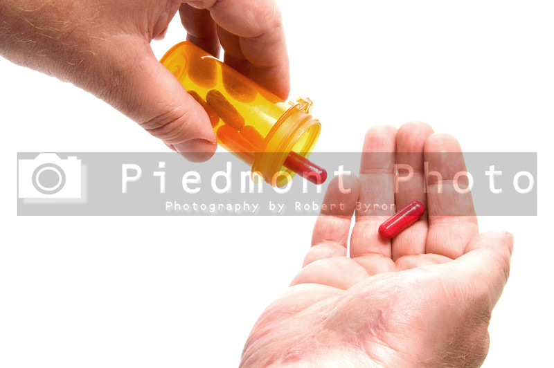 A person holding a prescription medical pill.
