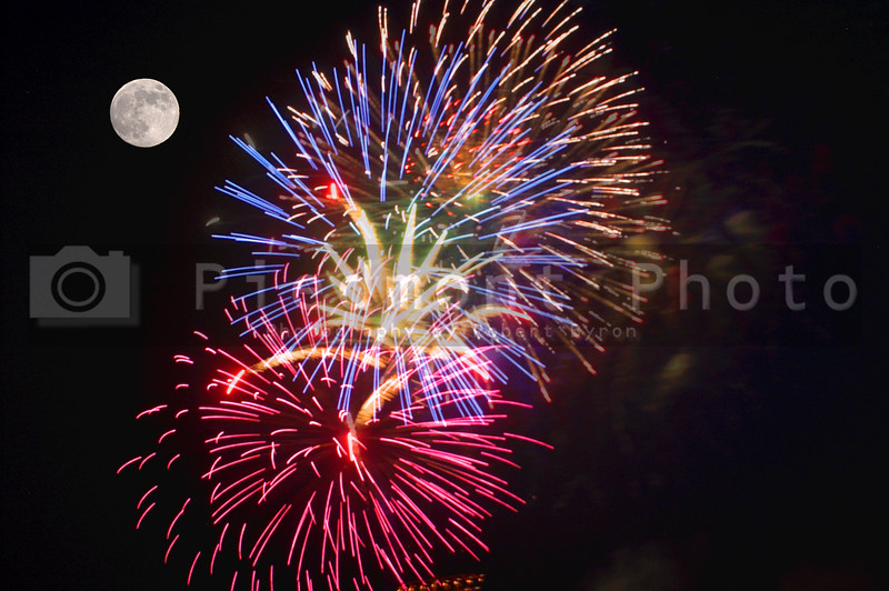 A fireworks display and a full moon.