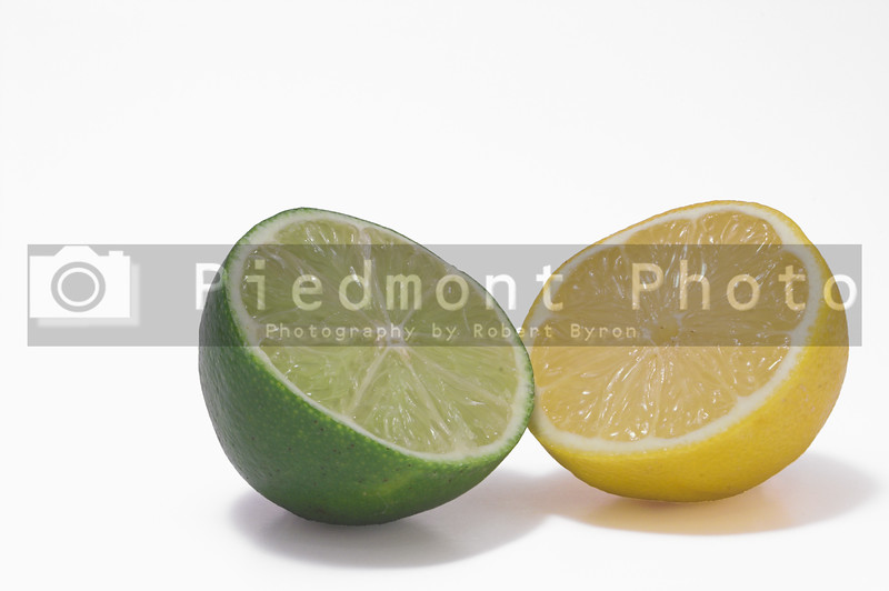 A yellow lemon and a gren lime.