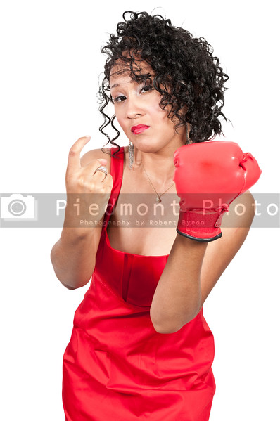 A beautiful young woman wearing a  boxing glove while motioning to come here