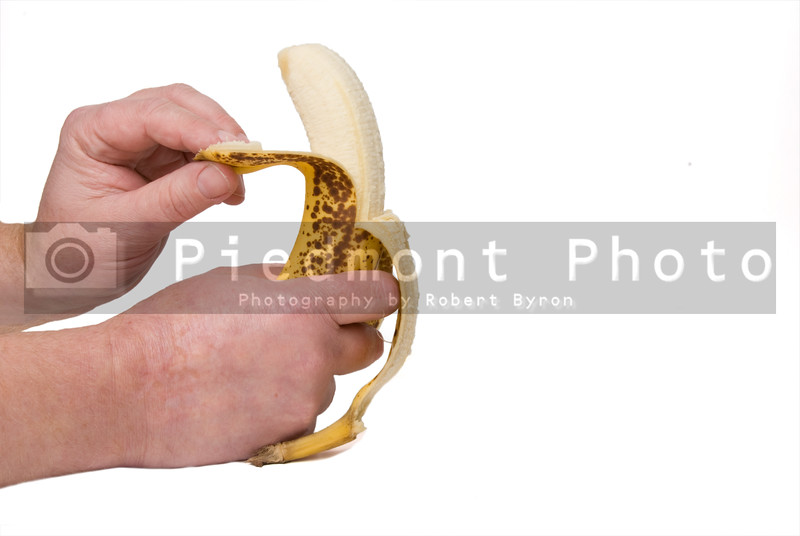 A person peeling a fresh and delicious banana.