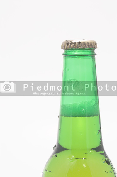 A delicious cold beer in a green bottle.