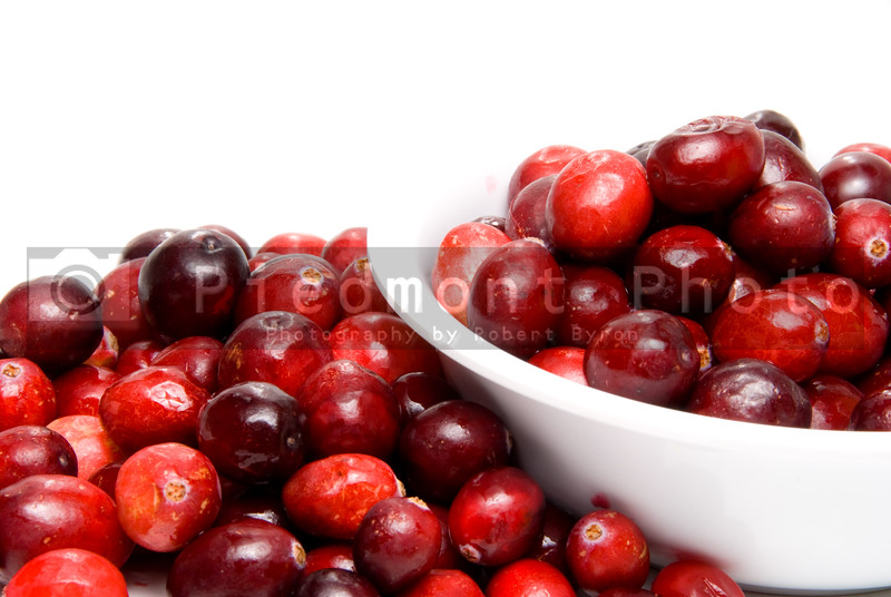 A big bowl of fresh delicious cranberries.
