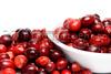 A big bowl of fresh delicious cranberries.