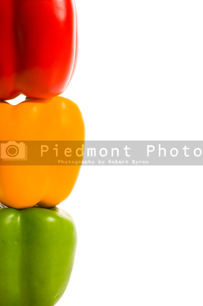 A stack of colorful and delicious stoplight peppers.