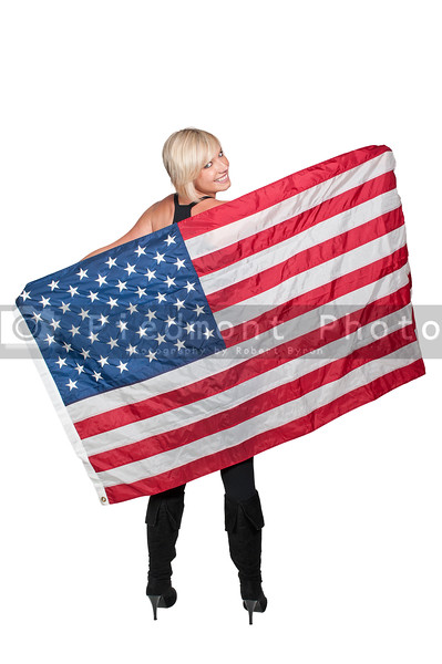 A beautiful young woman holding an American flag