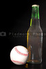 A baseball and a bottle of beer.