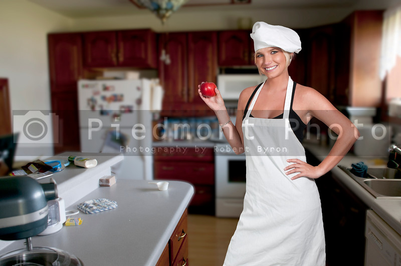 A young female woman chef showing her approval of the taste of food