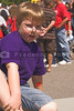 A boy in the crowd at a carnival event.