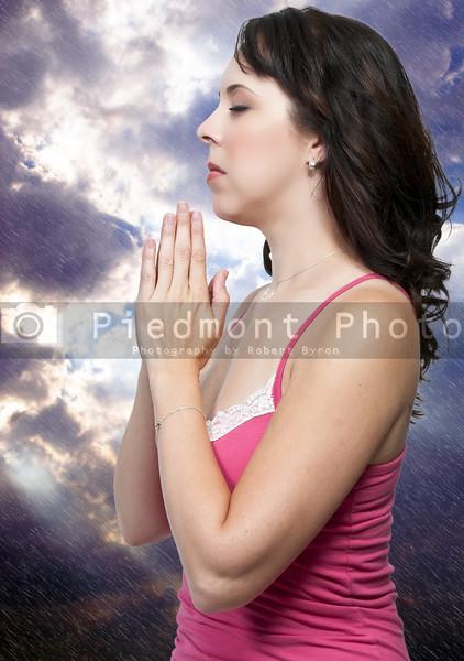 Beautiful Christian woman in a deep prayer