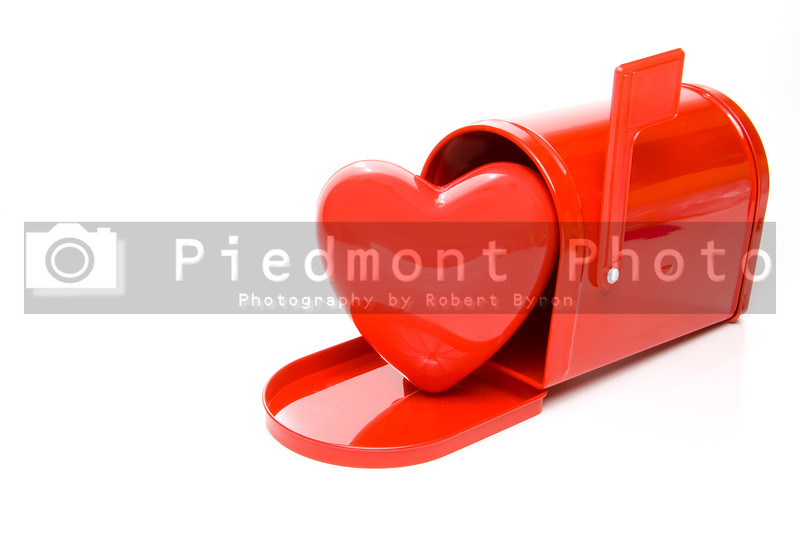 A red heart in a postal mailbox.