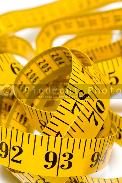A tailor's measuring tape coiled up randomly.