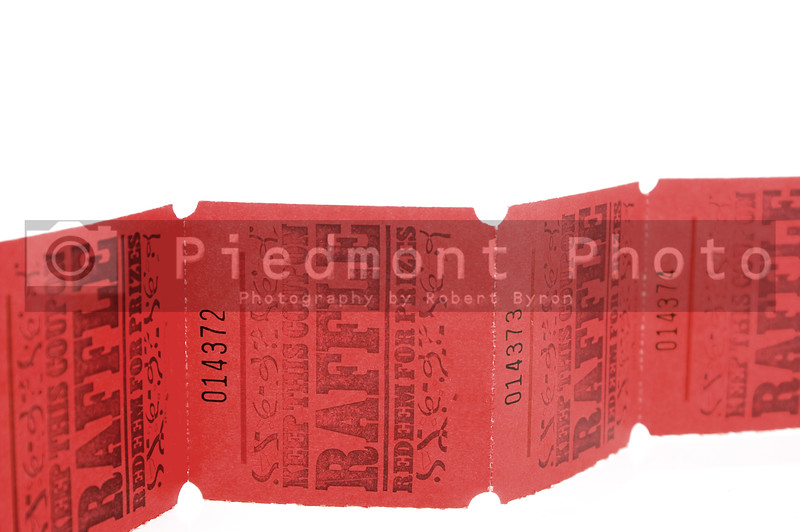 A strand of bright red rafflle tickets.