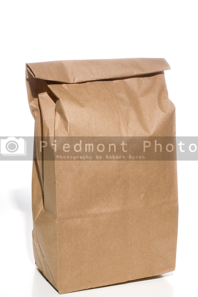 A brown bag lunch in a brown paper sack.