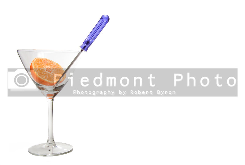 The ingredients of a screwdriver in a martini glass.
