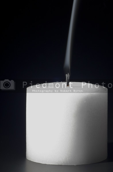 Smoke rising from a freshly snuffed candle.