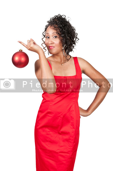 A beautiful young black woman holding a Christmas ornament