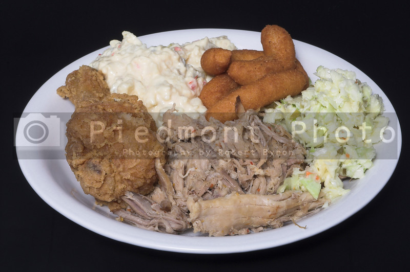 Fried Chicken, Pork Barbeque, Cole Slaw, Potato Salad and Hush Puppies