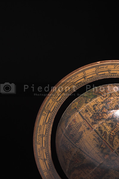 A globe of the Earth in shadow.