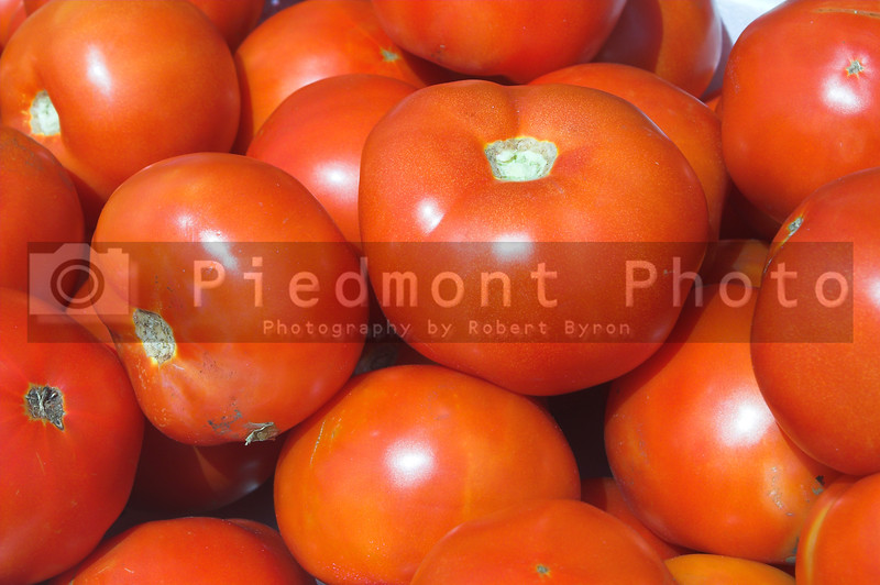 Fresh tomatoes for sale at a farmers market.