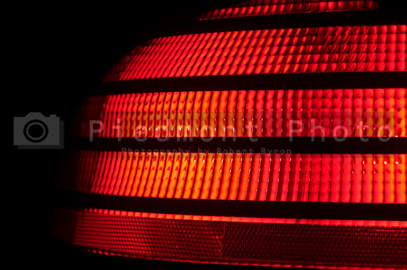 A red plastic automobile tail light signal.
