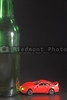 A drunk driver crashes his car into a giant beer bottle.